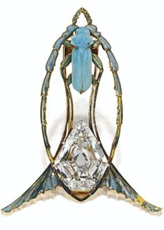 Lalique signed 1900 Art Nouveau Brooch: gold, diamond, enamel, glass.The stylized insect decor-ated w/a scarab beetle of pale blue opalescent glass above a calf's-head-cut diamond, w/in a modified navette-shaped frame w/fin terminals applied w/opales-cent enamel in shades of blue