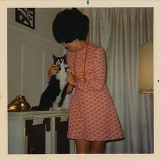 A chic young woman and her cat. Late 60s snapshot