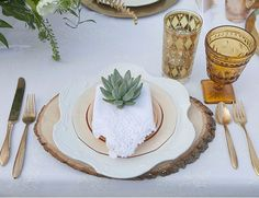succulent + vintage glassware + wood charger + gold silverware // baby shower