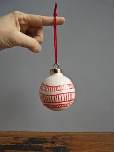 Hand-painted, one-of-a-kind ornaments are stocked in my shop! Perfect addition to a Christmas tree, in my opinion. :)