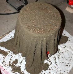 Soak A Towel In Wet Cement. After It Dries Turns It Over To Create A Planter or Bowl