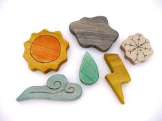 lovely wooden water symbols - i may create with felt