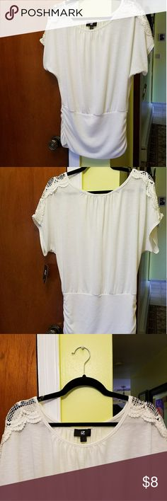 NWT loose fitting white summer top from iZ Byer New with tags. All white with embroidered/ lace shoulders. Size large and meant to have an oversized fit. Gathering at the waist making it figure flattering. All $8 tops have deals. Two for $13 or three for $18. Receive a FREE New or EUC bottle of nail polish with every $10 spent in my closet.iZ Iz Byer Tops Blouses