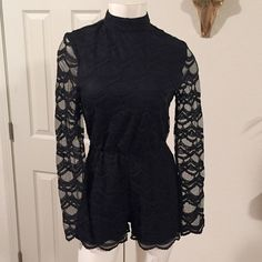Lenin stoned romper Brand new black faux turtleneck romper with cinched waistband and scalloped hemline. All over lace with exposed lace on the arm. Length is 29 inches. 60% cotton and 40% nylon. Price is FIRM- keeping it if it doesn't sell at listing. I don't trade Pants Jumpsuits & Rompers
