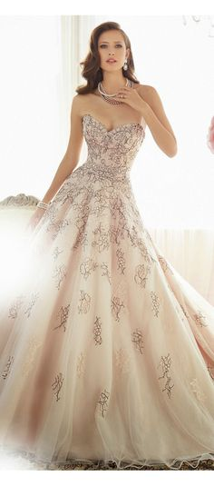 Blush wedding gown with black lace applique.