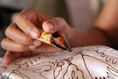 Batik. Heated wax applied to fabric.