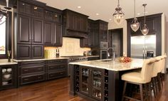 Furniture,Astounding Beautiful Contemporary Kitchen Design Ideas With Style Large Black Wood Kitchen Cabinet And Cool Kitchen Island In Black White Color Also Comfortable Cream Padded Wood Bar Stools Plus Antique Three Glass Pendant Lamp,Stunning Kitchen Decoration For Home