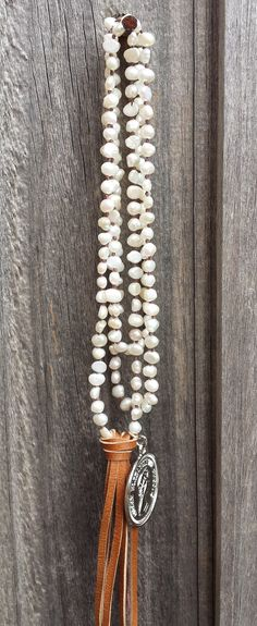 Long freshwater pearl necklace, with leather tassel