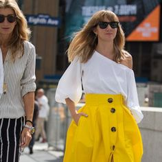 Editorial Eclectic summer street style, what the NYC fashion girls are wearing - 2017 is about maximalist styling - pops of bold color, outfits with texture, mixing prints, high low outfit styling with elements of athleisure like white sneakers with dresses. Cue the statement sleeves, ruffled shirts, oversized everything, wide leg pants and culottes and something Gucci. Dresses over jeans.