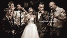 Would the Bride Care for a Cigar? Yes! http://tomhallphotography.com.au/groomsmen-and-bride-smoking-cigars/