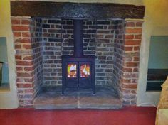 Charnwood island 1 multi fuel stove installed in an old Essex inglenook by Scarlett Fireplace in Canewdon 2010