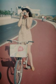 Girl with Camera and Bike By Among Dreams