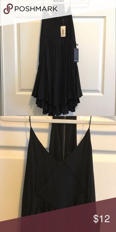 ✨NWT✨ Forever 21 Black Tiered Dress Tiered black flowy dress with thin straps. Zip up back. Perfect for summer. Can be paired with espadrilles or strappy sandals. Wanted to love this dress but it doesn't look good on me. Never used. Can fit xs, s, m Forever 21 Dresses Mini