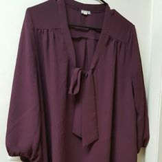 Plum Colored Flowy Blouse Plum colored flowy blouse. Looks great with skinny jeans or leggings and boots! Sleeves have elastic on the ends. Tops