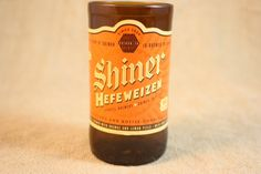 These Shiner Bock drinking glasses are made from recycled beer bottles. We cleaned, cut, grind, sand and polish these bottles to bring you a glass that you can drink from. The lip on the glasses are smooth.  App. 5 inches tall, holding 8 oz. of your favorite beverage.  This listing is for a SINGLE glass.  If you would like a different brand of bottle, take a look in our Recycled Bottle Glasses: http://www.etsy.com/shop/CountryRichDesigns?section_id=14009803 If you don...
