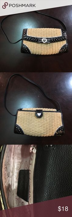 """BRIGHTON STRAW BAG BRIGHTON STRAW BAG, adorable straw, black, and white bag. Good condition however is used. Measures approximately 10inches 1 1/2"""" 13 1/2 inches Brighton Bags"""