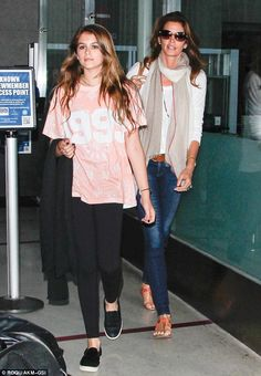 Double-take: Cindy Crawford walks with her lookalike daughter, Kaia through Los Angeles airport on Saturday