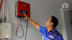 SUN-POWERED. Mike De Guzman has installed a device that turns electricity generated by his solar panels into a form that can power his appli...