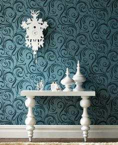 This wallpaper color & pattern, mixed with the simplicity of white makes my heart skip a beat.