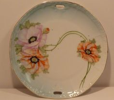 """Vintage Porcelain Plate with Handles Germany - Old German Fine China- Poppies FOR SALE • $9.95 • See Photos! Money Back Guarantee. Vintage Porcelain Plate with Handles Germany - Old German Fine China -Poppies 8.5"""" diameter.5 tall please see images for conditionall items sold as isany questions, please askthanks for looking! On 252900620864"""