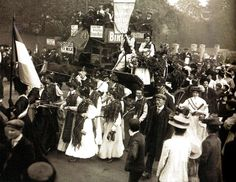 Mary Philips, one of the released Suffragettes, being drawn along in a carriage - UK - 1908