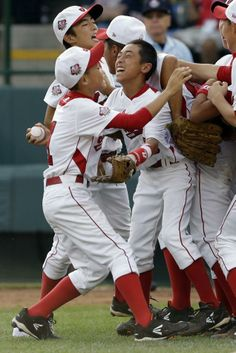 The Tokyo, Japan, Little League team celebrates after a 6-4 win over Chula Vista, Calif., in the Little League World Series Championship bas...