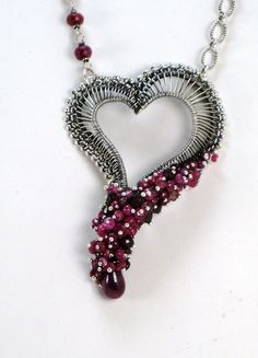 Heart Wire Wrapped Ruby Pink Tourmaline Garnet Sterling Silver Wirework Necklace. $375.00, via Etsy shop: HollyPresley