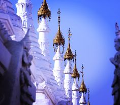 The beautiful tips of the largest book of the world. It's written on marble plates, stored in sweet Stupas in Mandalay.