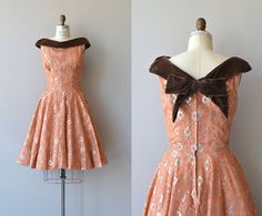 Vintage 50s or 60s dress in warm apricot, trimmed in velvet.
