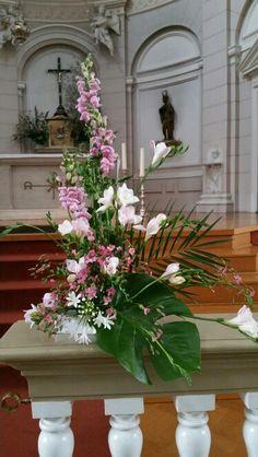 Liturgical flower arrangement. Church Altar
