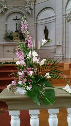 Liturgical flower arrangement. Church Altar