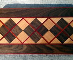http://www.instructables.com/id/How-To-Make-A-Fabulous-Argyle-Cutting-Board/