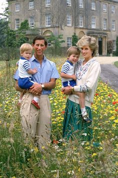 Charles, Prince of Wales, and Princess Diana with Prince William and Prince Harry in the wildflower meadow at Highgrove House