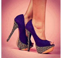Purple heels with a sparkly wedge...nice