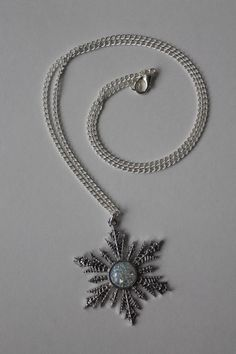 Anna Snowflake Necklace Once Upon A Time by FanVictory on Etsy https://www.etsy.com/listing/211243725/anna-snowflake-necklace-once-upon-a-time