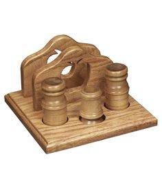 The napkin holder with apple design includes a salt and pepper shaker and toothpick holder.