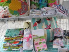 craft booth display - pillow covers, burp cloths, blankets...