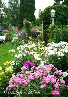 Charming, colorful backyard flowers and landscaping ideas and design from Aiken House & Gardens