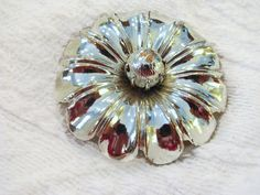SOLD Big chrome flower brooch. 3  inch. Unsigned beauty to jazz up a boring blazer.  etsy shop: VintageAngeline