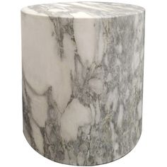 Carved out of a block of solid marble, this design can be used as a seat, plinth, or an occasional table and is perfect for a shower or a garden. The cylindrica...