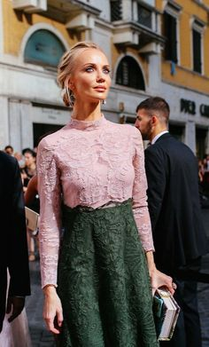 A color-block Valentino lace dress in blush and forest green