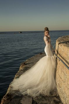Galia Lahav's beautiful Tullia gown made from dusted tan ivory and shimmering sheer side panels of lace magnificently mesmerizing with it's full lace silk skirt
