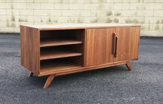 Ready to ship!  A classic styled mid century modern credenza. Made with a mix of walnut hardwood and veneer. Hand applied oil / poly satin finish. 3