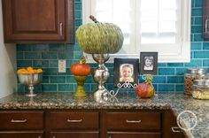 BH--love the color combo in this kitchen. Especially the teal blue tile backsplash!