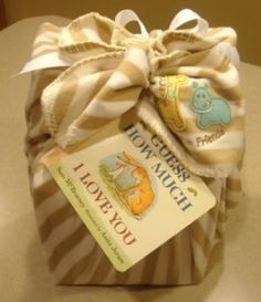 BABY PRESENT WRAPPED IN BABY BLANKET W/ BOOK AS CARD