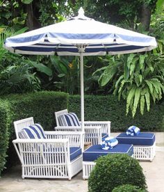 Preppy navy and white patio furniture make for the perfect seaside