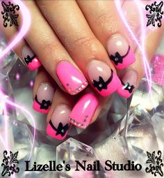 Hot pink with black bows & silver gems.  Hand-painted nail art. Sculpted gel nails  www.facebook.com/LizellesGelNails