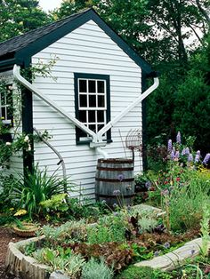 Catch the rain: A rain barrel under a downspout holds water until your plants need it. More green garden tips: http://www.midwestliving.com/garden/design/green-gardens/
