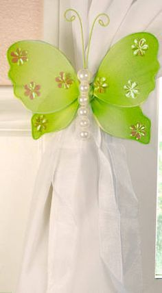 So darling for a little girl's room. Use a butterfly for a curtain tie back.