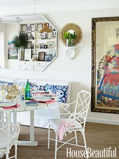 Dining area in a Bahamas home. Design: Amanda Lindroth. Photo: James Merrell. housebeautiful.com. #dining_room #teak #teak_table #vintage_chairs